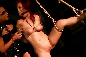 young domina punishing breasty redhead
