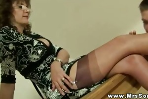 sexy breasty mature makes young fellow foot