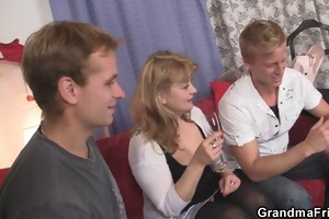 older babe in nylons takes two dicks at one time
