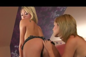 cute youthful blonde is enticed by a sexy asian
