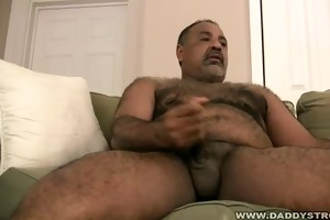 stocky daddy plays with his cock