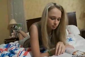 cute blond rita reads a magazine in ottoman when