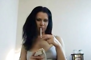 brunette bitch riding penis while smoking