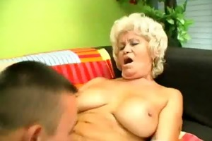 excited granny rides on a hard cock