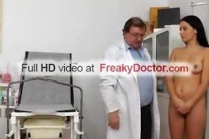 older gyn doctor widens wet crack of hot dark