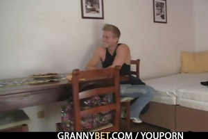 mature blond takes it from behind