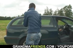 old slut enjoys threesome in the fields