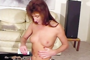 slim older lady rubs her meatballs with lotion