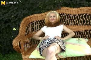 hot golden-haired mother playing with her wet
