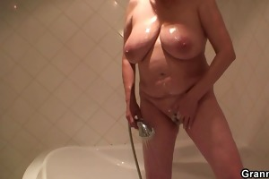 busty golden-haired granny pleases him after