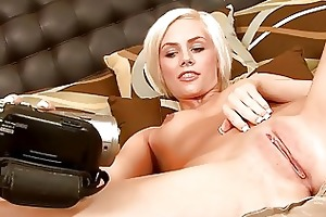 playful young blonde sticks glass fake penis up