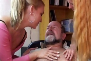 two sexy blondes having some fun with an old man