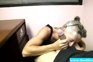older mother with spex engulfing pecker
